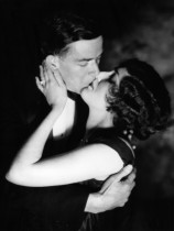 h-armstrong-roberts-1920s-1930s-romantic-couple-evening-dress-embracing-about-to-kiss